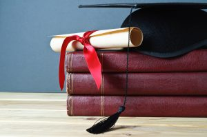 Diploma and Mortar board. Celebrities with PhDs.