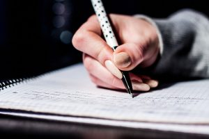 Crop hand writing on the notebook